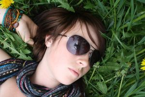 laying in grass.. by black-rose-red