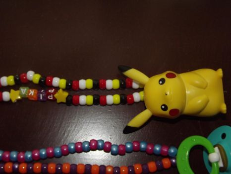 CLOSE UP on necklaces by TimoKachu
