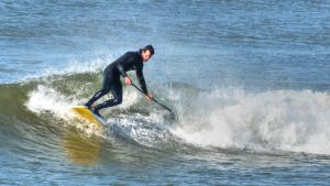 Surfing in Aber by CharmingPhotography