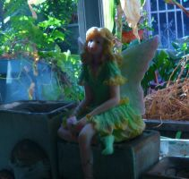 little fairy laying on the candle out of focus by MartinElMalo