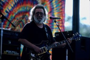 Jerry at the EEL in front of Stage tapestries by aliast
