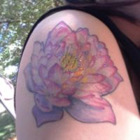 My lotus shoulder tattoo by magentaluv