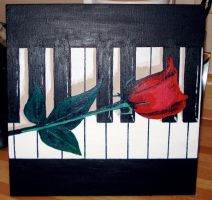Rose on Piano by LeelaB