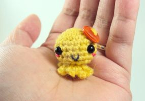 Mini Amigurumi Octie with Orange Heart Button by altearithe
