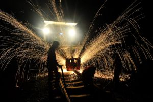 Welding on the rails, Cambodia by gatonegro2551