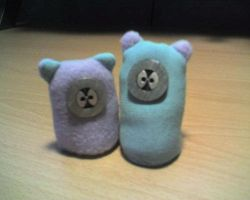 Mr. and Mrs. Button Face by Sya