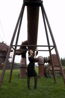 Girl Beneath Metal Structure by happeningstock