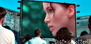 Katniss On The Big Screen In District 12 by DistrictPotter13