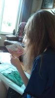 me cross stitching by dottypurrs