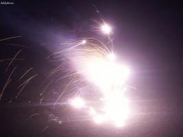 Sparks from a bright firework by ashleybroses