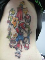 super mario rib tattoo by tattoosbyjon