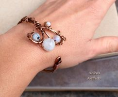 Copper wire wrapped bracelet with moonstone beads by IanirasArtifacts
