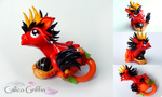 Malaika - red griffin - clay sculpture by CalicoGriffin