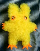 Fuzzy Yellow Baby Monster by treesofmachinery