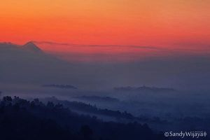 Borobudur and Mount Merapi by thesaintdevil