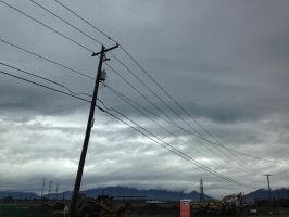 Construction, Powerline and Cloudy Skies by rainrivermusic