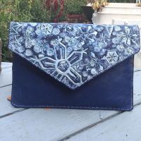 Leather snowflake envelope clutch by Katiefiorito