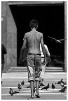 Young barefoot walking by anahuac