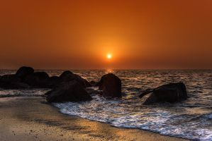 Sunset on the rocks by bullone65