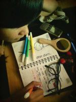 she's writting .. by dindaokeeh