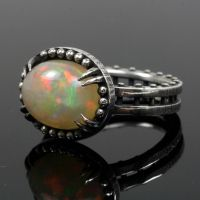 Ethiopian Opal Claw Ring by mooredesign13