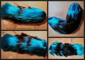 Turquoise and Black Yarn Tail by EvlonArts