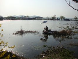 A man fishing in the lake by Laura-in-china