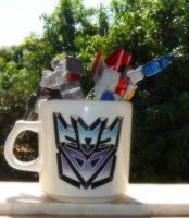 A nice cup of Decepticons by Kisachi