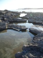 Rock pools at Claire Bay by Tamika87