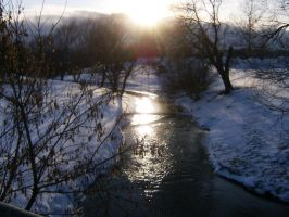 Sunset Over a Snowy River by nizati