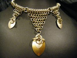 euro scale necklace by BacktoEarthCreations