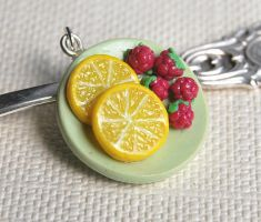Lemon and Raspberries by Madizzo
