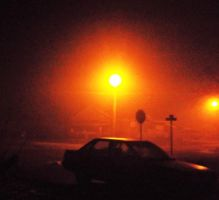 Foggy night and bright lights by MystMoonstruck