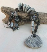Silver and black Necklace by desertwind56