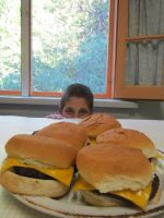 Kid with plate of burgers by pemeventskate
