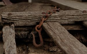 Rusty hook on textured wood by boron