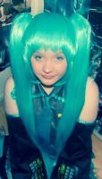 Sitting pretty closer up (Hatsune miku cosplay) by spirtofthedevil