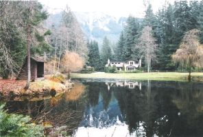 Pond with Mountains and House by happeningstock