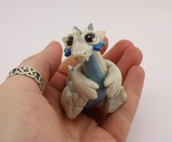 Baby White Dragon with Blue Accents by LitefootsLilBestiary