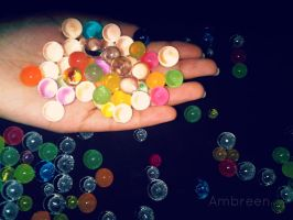 Water Marbles in hand by AmbreenKhanAmber