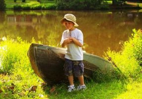 Boy and Boat in High Summer by jwebbermedia