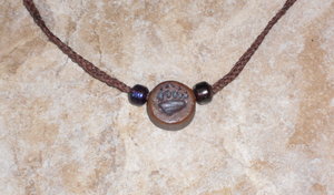 Ceramic Grizzly Bear Paw Print Necklace by Merytsetesh