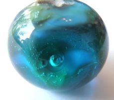 Lonely Earth lampwork bead by fairyfrog