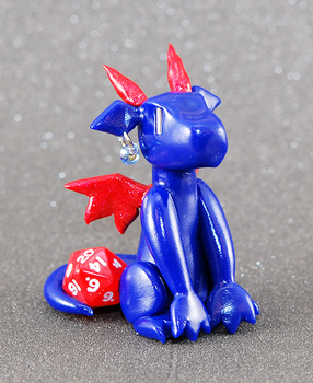 Blue and Red Dragon With a Mini d20 Die by HowManyDragons