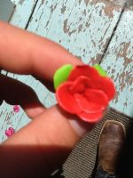 Red Fimo clay flower by flopypony