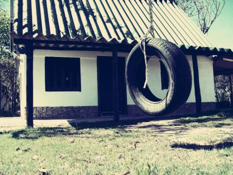 Cottage and a lonely tire by motorslut