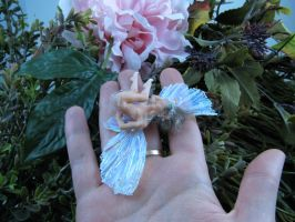 Thumb fairy on the hand by polymer-people