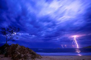 Storm Over Korora Bay by John-Alessi
