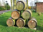 stacked wine barrels by schaduwvacht