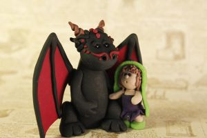 Dragon and Little Girl Sculpture by lizayle